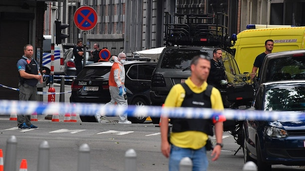 Police investigate at the scene of a shooting in Liege, Belgium, Tuesday, May 29, 2018. A gunman killed three people, including two police officers, in the Belgian city of Liege on Tuesday, a city official said. Police later killed the attacker, and other officers were wounded in the shooting.(AP Photo/Geert Vanden Wijngaert) Suspect accused of killing 3, including 2 cops, in Belgium mentioned in radicalization reports Suspect accused of killing 3, including 2 cops, in Belgium mentioned in radicalization reports 1527597709917