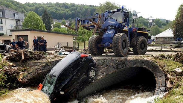 A car is pulled out of the floods in the small city of Herrstein, southern Germany, Monday, May 28, 2018. Heavy rain on the evening before caused flooding destroying big parts of the village. (Harald Tittel/dpa via AP) Two women taking selfies seriously injured after being struck by lightning Two women taking selfies seriously injured after being struck by lightning 1527603573512