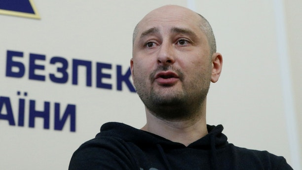 Russian journalist Arkady Babchenko, who was reported murdered in the Ukrainian capital on May 29, speaks during a news briefing by the Ukrainian state security service in Kiev, Ukraine May 30, 2018. REUTERS/Valentyn Ogirenko - RC1575871BE0