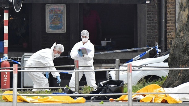 Police investigate at the scene of a shooting in Liege, Belgium, Tuesday, May 29, 2018. A gunman killed three people, including two police officers, in the Belgian city of Liege on Tuesday, a city official said. Police later killed the attacker, and other officers were wounded in the shooting.(AP Photo/Geert Vanden Wijngaert)