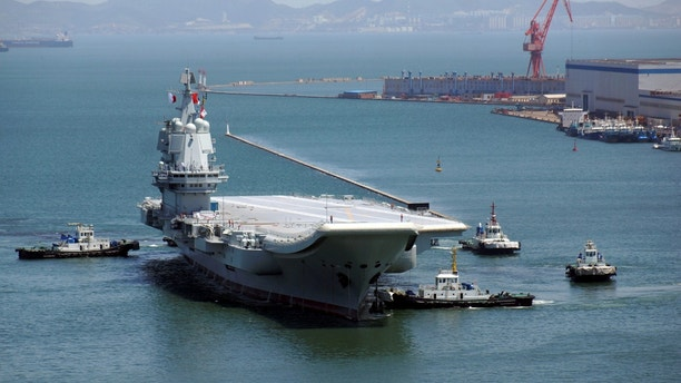 China's first domestically developed aircraft carrier is seen at a port in Dalian after completing its first sea trials, in Liaoning province, China May 18, 2018. Picture taken May 18, 2018. REUTERS/Stringer ATTENTION EDITORS - THIS IMAGE WAS PROVIDED BY A THIRD PARTY. CHINA OUT. - RC1454B80000