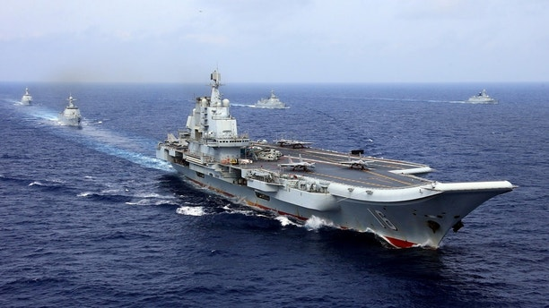 China's aircraft carrier Liaoning takes part in a military drill of Chinese People's Liberation Army (PLA) Navy in the western Pacific Ocean, April 18, 2018. Picture taken April 18, 2018. REUTERS/Stringer ATTENTION EDITORS - THIS IMAGE WAS PROVIDED BY A THIRD PARTY. CHINA OUT. - RC11EB768B30