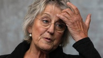 Author Germaine Greer gestures at a media launch in Melbourne August 21, 2008. Greer is the keynote speaker at the Melbourne Writers Festival which begins on August 22. REUTERS/Mick Tsikas (AUSTRALIA) - GM1E48L13E801