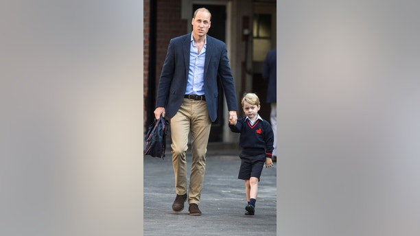 Britain's Prince William accompanies his son Prince George on his first day of school at Thomas's school in Battersea, London, September 7, 2017. REUTERS/Richard Pohle/Pool - RC1A7646FC70