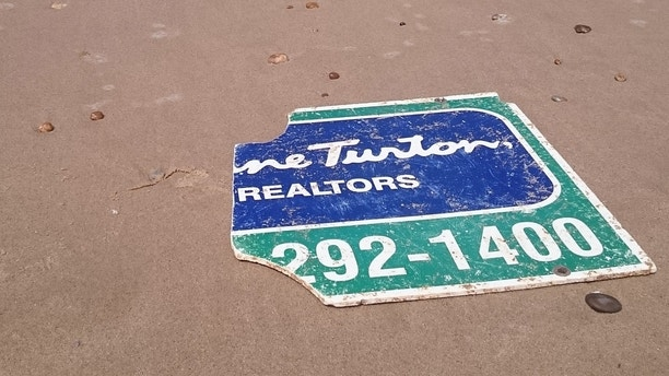 NJ realty sign lost during Hurricane Sandy found on beach in France