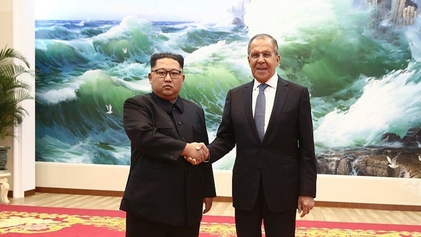 Korean leader Kim Jong Un, left, and Russia's Foreign Minister Sergei Lavrov pose for a photo during a meeting in Pyongyang, North Korea, Thursday, May 31, 2018 . Lavrov's visit to North Korea comes ahead of a planned summit between President Donald Trump and North Korean leader Kim Jong Un and is seen as an attempt by Moscow to ensure its voice is heard in the North's diplomatic overtures with Washington, Seoul and Beijing.(Valery Sharifulin/TASS News Agency Pool Photo via AP)
