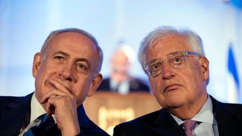 FILE - In this May 21, 2017, file photo, Israeli Prime Minister Benjamin Netanyahu, left and David Friedman, right, the new United States Ambassador to Israel attend a ceremony celebrating the 50th anniversary of the liberation and unification of Jerusalem, in front of the walls of the Old City of Jerusalem. AP sources say President Donald Trump is considering giving Friedman more authority over the U.S. outpost that handles Palestinian affairs, a shift likely to further dampen Palestinian hopes for an independent state. (Abir Sultan/Pool Photo via AP, File)