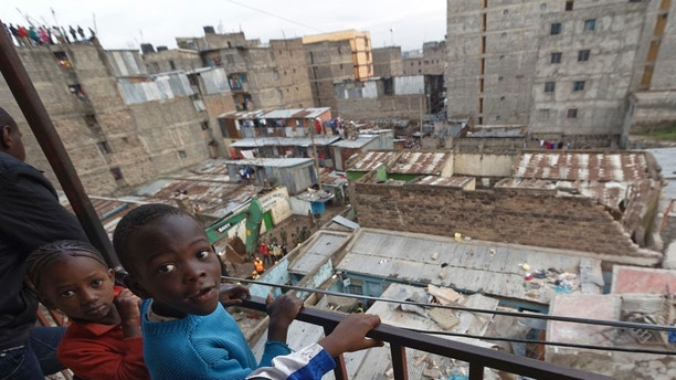 Child residents of a neighboring building look out over their balcony at the scene of a five-storey collapsed building in the Huruma neighborhood of Nairobi, Kenya Sunday, June 3, 2018. An official from Kenya's Disaster Management Unit at the scene said that two had died, a number were injured, some were still missing, but that many residents of the building had managed to escape before the building fully collapsed. (AP Photo/Ben Curtis)