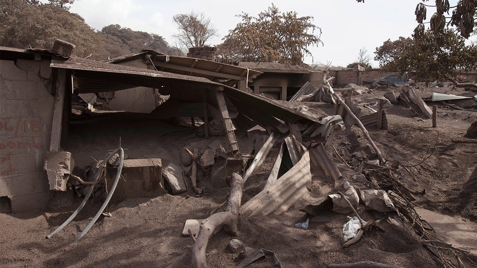 """Volcanic ash blankets a home destroyed by the Volcan de Fuego, or """"Volcano of Fire,"""" eruption, in Escuintla, Guatemala."""