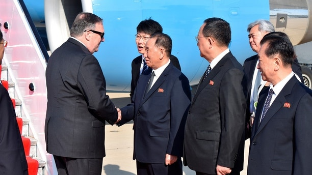U.S. Secretary of State Mike Pompeo is greeted by senior North Korean official Kim Yong Chol, director of the United Front Department, which is responsible for North-South Korea affairs and Foreign Minister Ri Su Yong, on his arrival in Pyongyang, North Korea May 9, 2018. Pompeo met with North Korean leader Kim Jong Il later and secured the release of three American prisoners ahead of a planned summit between Kim and President Donald Trump. Matthew Lee/Pool via REUTERS - RC1E4B1242E0