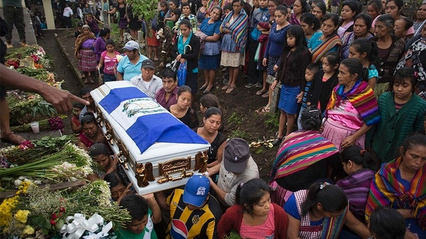 Family members of Erick Rivas, 20, who died in the hospital after suffering burns from the eruption of the Volcan de Fuego, which in Spanish means Volcano of Fire, carry his remains to the cemetery in San Juan Alotenango, Guatemala, Wednesday, June 6, 2018. On the day of the eruption, Sunday, Rivas was returning home from the town of San Miguel Los Lotes after visiting his girlfriend, who survived. (AP Photo/Luis Soto)