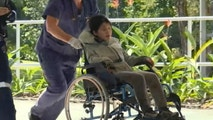 In this photo taken from the Australian Broadcasting Corporation video, South Korean backpacker Joohee Han, 25, is wheeled  to a hospital after being rescued by helicopter, Thursday, June 7, 2018, in Tully, Queensland, Australia. Police say a South Korean backpacker has been rescued after being lost for six nights in rugged Australian wilderness suffering from dehydration and exposure but relatively unscathed. (Australian Broadcasting Corporation via AP)