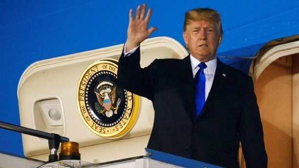 President Donald Trump arrives at Paya Lebar Air Base for a summit with North Korean leader Kim Jong Un, Sunday, June 10, 2018, in Singapore. (AP Photo/Evan Vucci)