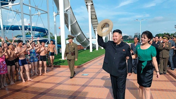 North Korean leader Kim Jong-Un and his wife Ri Sol-Ju attend the opening ceremony of the Rungna People's Pleasure Ground on Rungna Islet along the Taedong River in Pyongyang in this July 25, 2012 photograph released by the North's KCNA to Reuters on July 26, 2012.The Rungna People's Pleasure Ground has attractions such as a dolphinarium, a wading pool, a fun fair and a mini golf course, according to KCNA. REUTERS/KCNA (NORTH KOREA - Tags: POLITICS SOCIETY TPX IMAGES OF THE DAY) FOR EDITORIAL USE ONLY. NOT FOR SALE FOR MARKETING OR ADVERTISING CAMPAIGNS. THIS IMAGE HAS BEEN SUPPLIED BY A THIRD PARTY. IT IS DISTRIBUTED, EXACTLY AS RECEIVED BY REUTERS, AS A SERVICE TO CLIENTS. NO THIRD PARTY SALES. NOT FOR USE BY REUTERS THIRD PARTY DISTRIBUTORS - GM1E87Q0V6X01