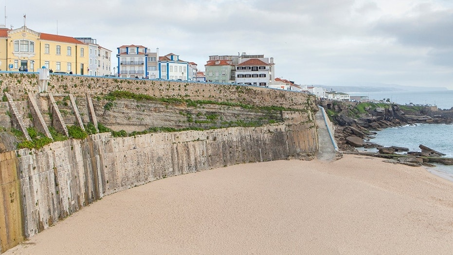 The British and Australian tourists died after they fell 100 feet off a wall at Portugal's Pescadores beach in Ericeira, a popular tourist and surfing spot