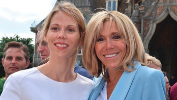 Brigitte Macron (R), wife of French President Emmanuel Macron, and her daughter Tiphaine Auziere (L) pose as they leave a polling station after voting for the second round of the French parlamentiary elections (elections legislatives in French) in Le Touquet, northern France, on June 18, 2017. / AFP PHOTO / Philippe HUGUEN        (Photo credit should read PHILIPPE HUGUEN/AFP/Getty Images)