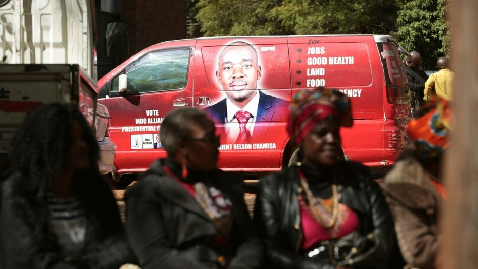 Supporters of Zimbabwes main oppositon leader, Nelson Chamisa are seen close to his campaign vehicle outside the magistrates courts in Harare, Thursday, June, 14, 2018.
