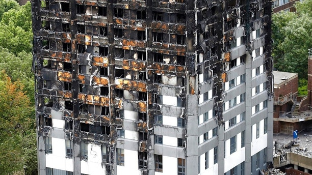 The burnt Grenfell Tower apartment building standing testament to the recent fire in London, Friday, June 23, 2017.  British officials have ordered an immediate examination Friday, into a fridge-freezer that is deemed to have started the fire in the 24-storey high-rise apartment building early morning of June 14th, and the outside cladding of the building which is thought to have helped spread the fire, according to police, leaving dozens dead.(AP Photo/Frank Augstein)
