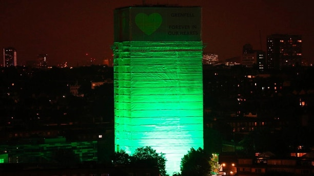 Grenfell Tower in west London is illuminated in green to mark a year since the moment the devastating fire took hold, claiming 72 lives, Thursday June 14, 2018. Thursday marks 12 months since a small kitchen fire in the high-rise turned into the most deadly domestic blaze since the Second World War. (Jonathan Brady/PA via AP)