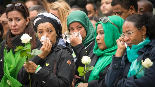 Families of victims of the Grenfell Tower disaster attend a service of remembrance in west London, Thursday, June 14, 2018. A year ago, London's Grenfell Tower high-rise was destroyed by a fire that killed 72 people. It was Britain's greatest loss of life by fire since World War II. On Thursday survivors, bereaved families and people around Britain will mark the anniversary of a local tragedy that's also a national shame - one for which blame is still being traded. (Stefan Rousseau/Pool Photo via AP)