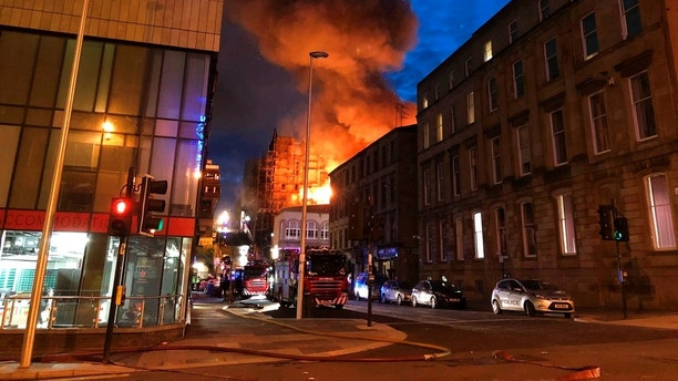 Flames and smoke rise from the Glasgow School of Art's Mackintosh Building in London, early Saturday, June 16, 2018. A large blaze ripped through the building at the Glasgow School of Art late Friday, the second time in four years that fire has damaged the famed Scottish school. (Douglas Barrie/PA via AP)