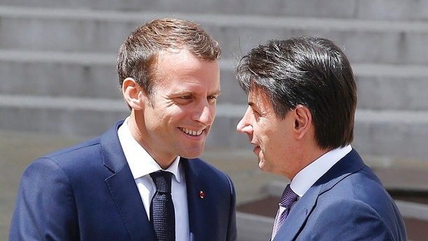 French President Emmanuel Macron, left, welcomes Italian Premier Giuseppe Conte at the Elysee Palace in Paris, France, Friday, June 15, 2018. French President Emmanuel Macron and new Italian Premier Giuseppe Conte meet Friday amid tensions between the two countries over migration. (AP Photo/Michel Euler)