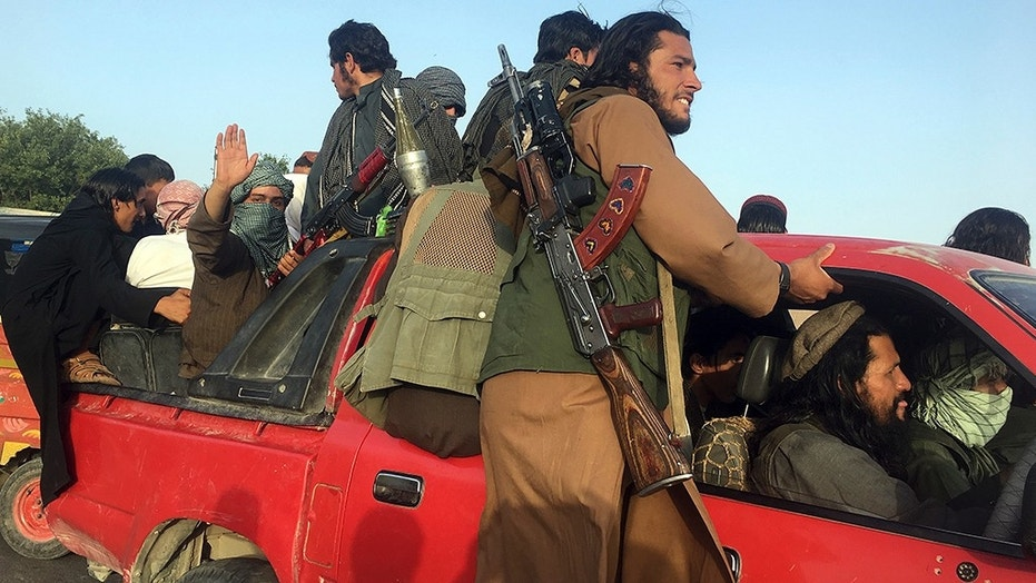 Taliban fighters ride in their vehicle east of Kabul, Afghanistan, on Saturday.  Suicide bomber kills 26, mostly Taliban celebrating truce in eastern Afghanistan 1529175635121