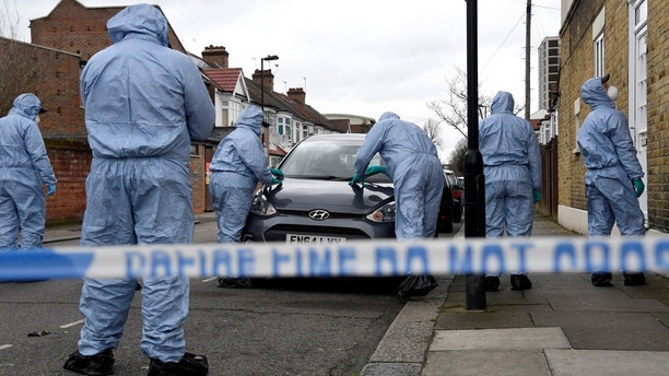 Forensic investigators examine a car on Chalgrove Road, where a teenage girl was murdered, in Tottenham, Britain, April 3, 2018. REUTERS/Toby Melville - RC1CC5C2D560