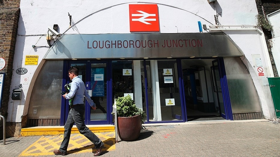 June 18, 2018: A man walks past Loughborough Junction railway station in south London.