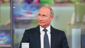 "Russian President Vladimir Putin smiles while answering a question during his annual call-in show in Moscow, Russia, Thursday, June 7, 2018. Speaking at the opening of his annual call-in television show, Putin said on Thursday that Russia's gross domestic product is currently 1.5 percent higher than a year ago. He described it as modest but said he is confident that future ""growth is guaranteed."" (Mikhail Klimentyev, Sputnik, Kremlin Pool Photo via AP)"
