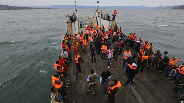 An Indonesia search and rescue team searches for a ferry which sank Monday in lake Toba, North Sumatra, Indonesia, Tuesday, June 19, 2018. Rescuers searching for dozens of people missing after a ferry sank on Indonesia's Lake Toba have found bags, jackets, an ID card and other items in the waters but no new survivors, casting a tragic pall over holidays marking the end of the Muslim holy month. (AP Photo)