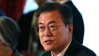 South Korea's President Moon Jae-in, right,  attends their trilateral summit with Japan's Prime Minister Shinzo Abe and Chinese Premier Li Keqiang at Akasaka Palace state guest house in Tokyo, Japan May 9, 2018. The summit is expected to focus on North Korea's nuclear program and on improving the sometimes-frayed ties among the three northeast Asian neighbors. (Kim Kyung-Hoon/Pool Photo via AP)