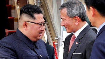 In this photo released by the Ministry of Communications and Information of Singapore, North Korean leader Kim Jong Un, left, is greeted by Singapore Minister for Foreign Affairs Dr Vivian Balakrishnan at the Changi International Airport, Sunday, June 10, 2018, in Singapore, ahead of a summit with U.S. President Donald Trump. (Ministry of Communications and Information Singapore via AP)