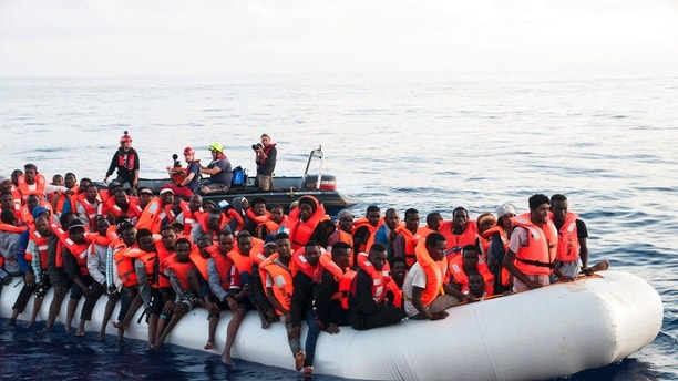 In this photo taken on Thursday, June 21, 2018, migrants on a rubber boat are being rescued by the ship operated by the German NGO Mission Lifeline in the Mediterranean Sea in front of the Libyan coast. Italy's interior minister says Malta should allow a Dutch-flagged rescue ship carrying 224 migrants to make port there because the ship is now in Maltese waters. Salvini said the rescue was in Libyan waters, which Lifeline denies. [Hermine Poschmann/Mission Lifeline via AP)