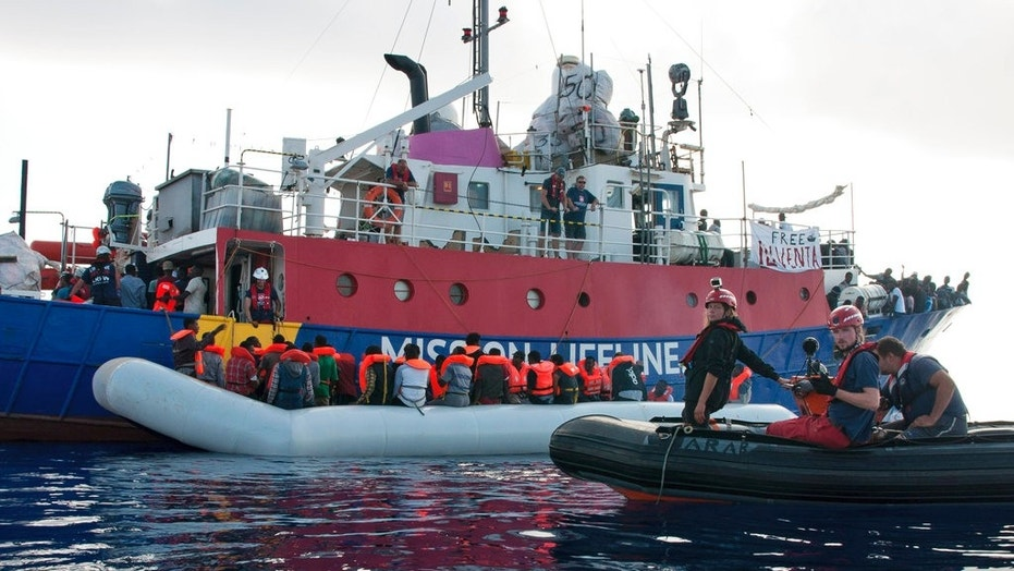 In this photo taken on Thursday, June 21, 2018, the ship operated by the German NGO Mission Lifeline rescues migrants from a rubber boat in the Mediterranean Sea in front of the Libyan coast. The ship is now adrift after Italy and Malta refused to allow it to dock  Spain rescues 569 migrants crossing the Mediterranean from Africa 1529766855765