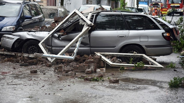 A car is destroyed after an explosion of a house in Wuppertal, Germany, June 24, 2018. German police say 25 people were injured, when an explosion destroyed a several-store building in the western city of Wuppertal. (Henning Kaiser/dpa via AP)