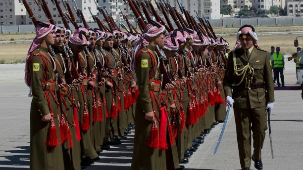 A Jordanian army officer inspects the honor guard in preparation for the arrival of Britain's Prince William, at Marka Airport in Amman, Jordan, Sunday, June 24, 2018. Britain's Prince William kicked off a politically delicate five-day tour of Jordan, Israel and the Palestinian territories. He plans to meet with young people, refugees and political leaders in a tumultuous region Britain had controlled between the two world wars. (AP Photo/Nasser Nasser)