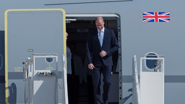 Britain's Prince William disembarks from a Royal Air Force plane after landing at the Marka airport in Amman, Jordan, Sunday, June 24, 2018. Britain's Prince William has kicked off a politically delicate five-day tour of Jordan, Israel and the Palestinian territories. He plans to meet with young people, refugees and political leaders in a tumultuous region Britain had controlled between the two world wars.  (AP Photo/Nasser Nasser)