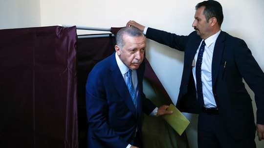 Turkey's President and ruling Justice and Development Party, or AKP, leader Recep Tayyip Erdogan comes out of a voting booth to cast his ballot in Turkey's elections at a polling station in Istanbul, Sunday, June 24, 2018. Turkish voters are voting Sunday in a historic double election for the presidency and parliament. (AP Photo/Lefteris Pitarakis)