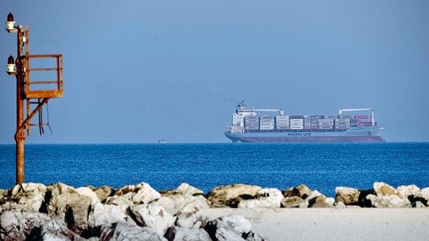 Danish-flagged commercial liner Alexander Maersk is off Sicily's coast Monday June 25, 2018 as it waits for a port to disembark the more than 100 people it had rescued. The cargo ship was involved in a rescue last Thursday along with the German aid group Mission Lifeline, whose ship is stranded off Malta with 234 migrants. (AP Photo/Salvatore Cavalli)