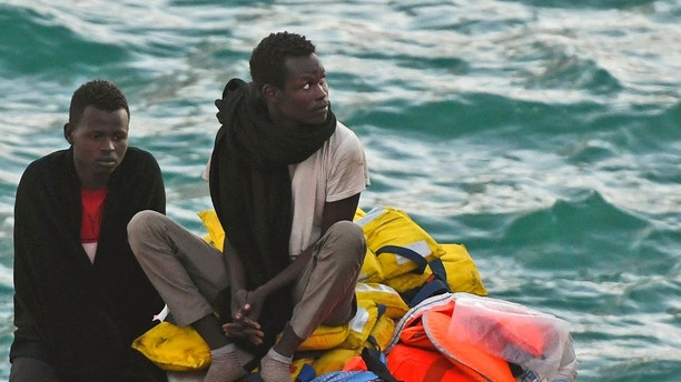 Migrants wait to be disembarked from the ship operated by German aid group Mission Lifeline, carrying 234 migrants, as it docked at the Valletta port in Malta, after a journey of nearly a week while awaiting permission to make landfall, Wednesday, June 27, 2018. Eight European nations agreed to accept the passengers who qualify as refugees. (AP Photo/Jonathan Borg)