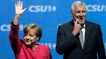 FILE - In this Sept. 22, 2017 file photo German Chancellor and Christian Democratic Union (CDU) party chairwoman Angela Merkel waves after her speech at an election campaign rally besides Bavarian state governor Horst Seehofer in Munich. (AP Photo/Matthias Schrader, file)