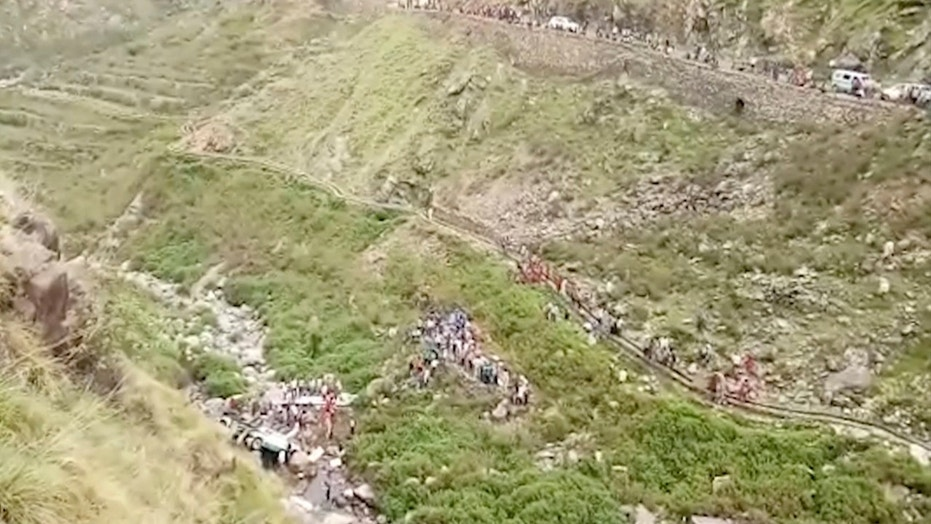 In this grab made from video provided by KK Productions, shows the area of a deadly bus accident in Uttarakhand's Paudi Garhwal district, northern India, Sunday, July 1, 2018. Chief Minister of Uttarakhand state Trivendra Rawat said the bus fell into a 700-foot (213-meter) deep gorge in the Himalayan foothills. (KK Production via AP)