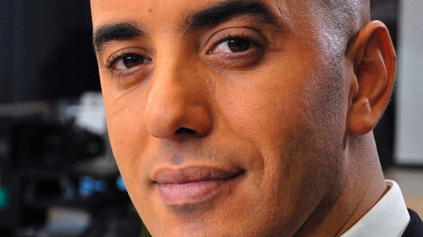 In this photo dated Nov. 22, 2010, notorious French criminal Redoine Faid poses prior to an interview with French all-news TV channel, LCI, as he was promoting his book, in Boulogne-Billancourt, outside Paris, France.  Faid serving 25 years for murder made an audacious escape from prison Sunday after a helicopter carrying several heavily armed commandos landed in a courtyard, freed him from a visiting room and carried him away. (IBO/Sipa via AP)