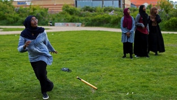"""A group of women of Somali descent play rounders in a park in Mjolnerparken, a housing estate that features on the Danish government's """"Ghetto List"""", in Copenhagen, Denmark, May 12, 2018. REUTERS/Andrew Kelly"""