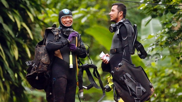 Thai rescuers prepare for diving after the 12 boys and their soccer coach were found alive, in Mae Sai, Chiang Rai province, in northern Thailand, Tuesday, July 3, 2018. The 12 boys and soccer coach found after 10 days are mostly in stable medical condition and have received high-protein liquid food, officials said Tuesday, though it is not known when they will be able to go home. (AP Photo/Sakchai Lalit)