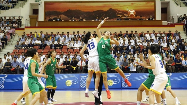 South and North Korean players of Team Peace, in white, and Team Prosperity play during a friendly basketball game at Ryugyong Jong Ju Yong Gymnasium in Pyongyang, North Korea, Wednesday, July 4, 2018. The rival Koreas on Wednesday began two days of friendly basketball games in Pyongyang in their latest goodwill gesture amid a diplomatic push to resolve the nuclear standoff with North Korea. (Korea Pool via AP)