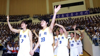"South and North Korean players of Team Peace wave as they arrive to play in a friendly basketball game at Ryugyong Jong Ju Yong Gymnasium in Pyongyang, North Korea, Wednesday, July 4, 2018. The rival Koreas on Wednesday began two days of friendly basketball games in Pyongyang in their latest goodwill gesture amid a diplomatic push to resolve the nuclear standoff with North Korea. Their uniforms read: ""Peace."" (Korea Pool via AP)"