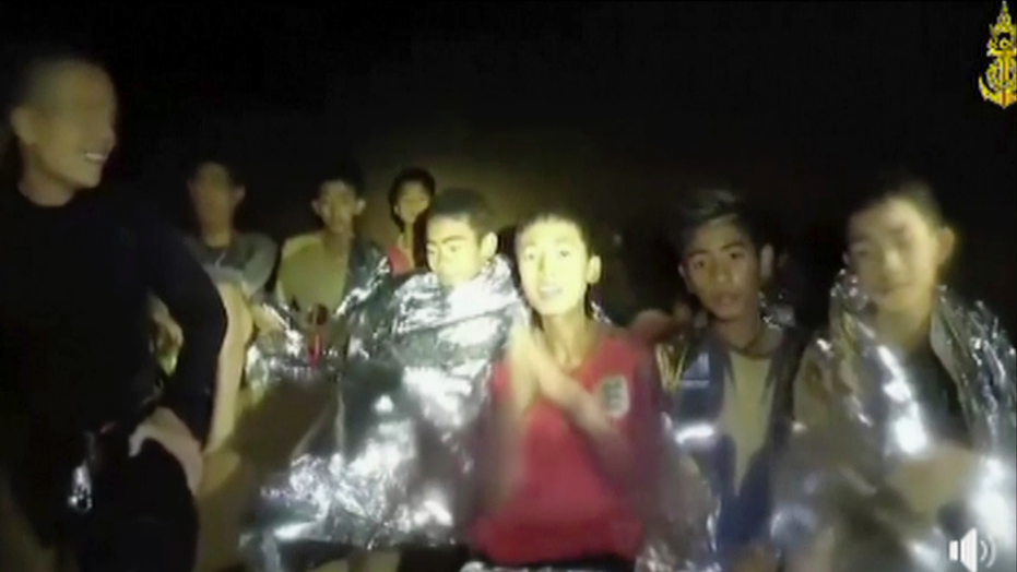 Rescuers race to drain water inside Thai cave before rains