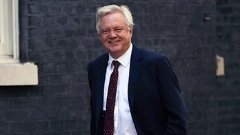 Exiting the European Union (Brexit) Secretary David Davis arrives in Downing Street, London, for a Cabinet meeting, Tuesday July 3, 2018.  May's Cabinet are scheduled to meet on upcoming Friday at the prime minister's country house Chequers to hammer out a unified position on the U.K.'s future relationship with the EU. (Stefan Rousseau/PA via AP)
